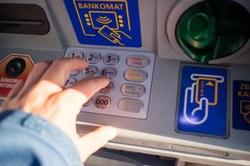 Retirer de l'argent à un bancontact : vigilance !